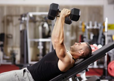 Athletic man working his chest